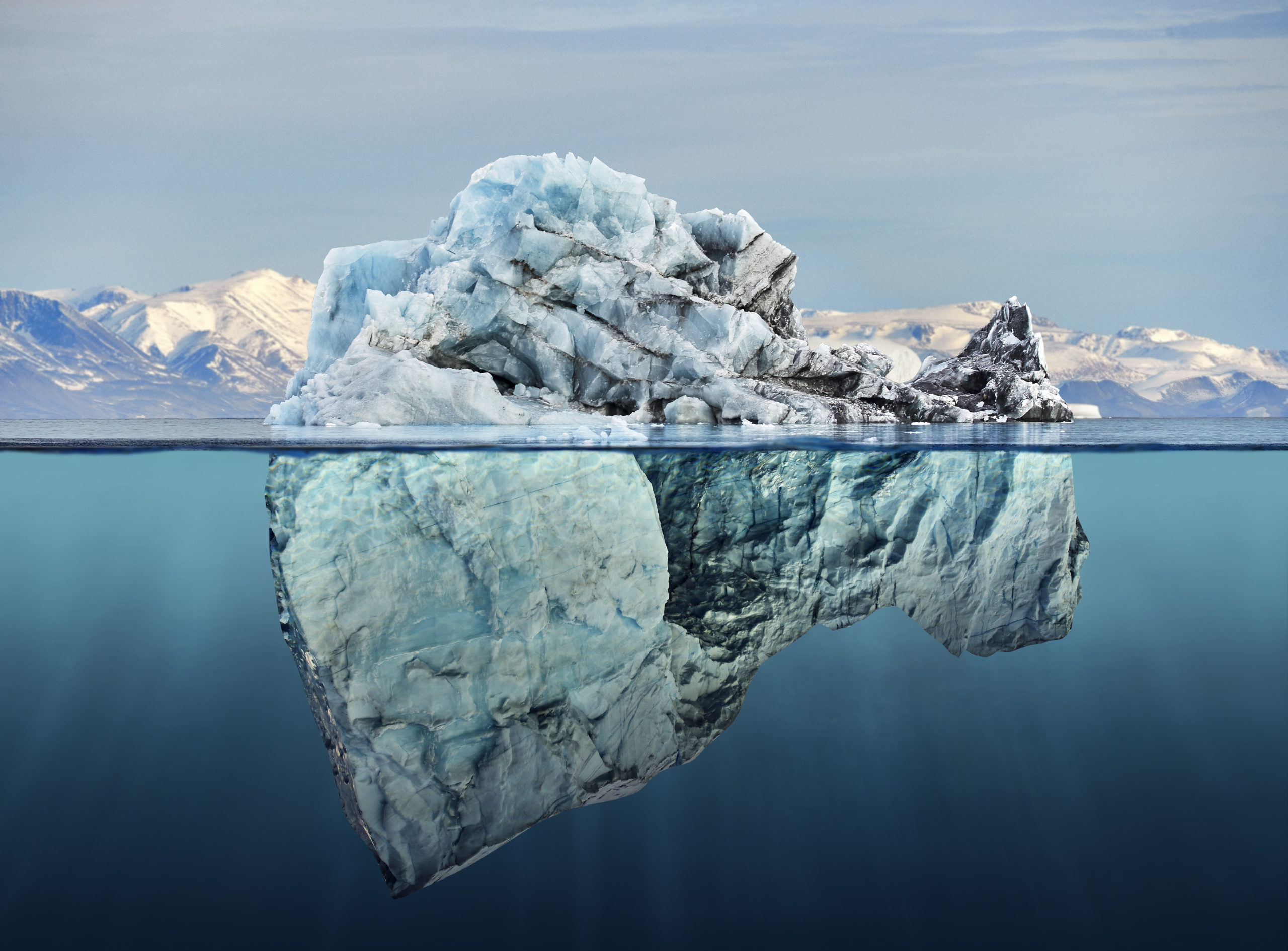 iceberg with above and underwater view taken in greenland